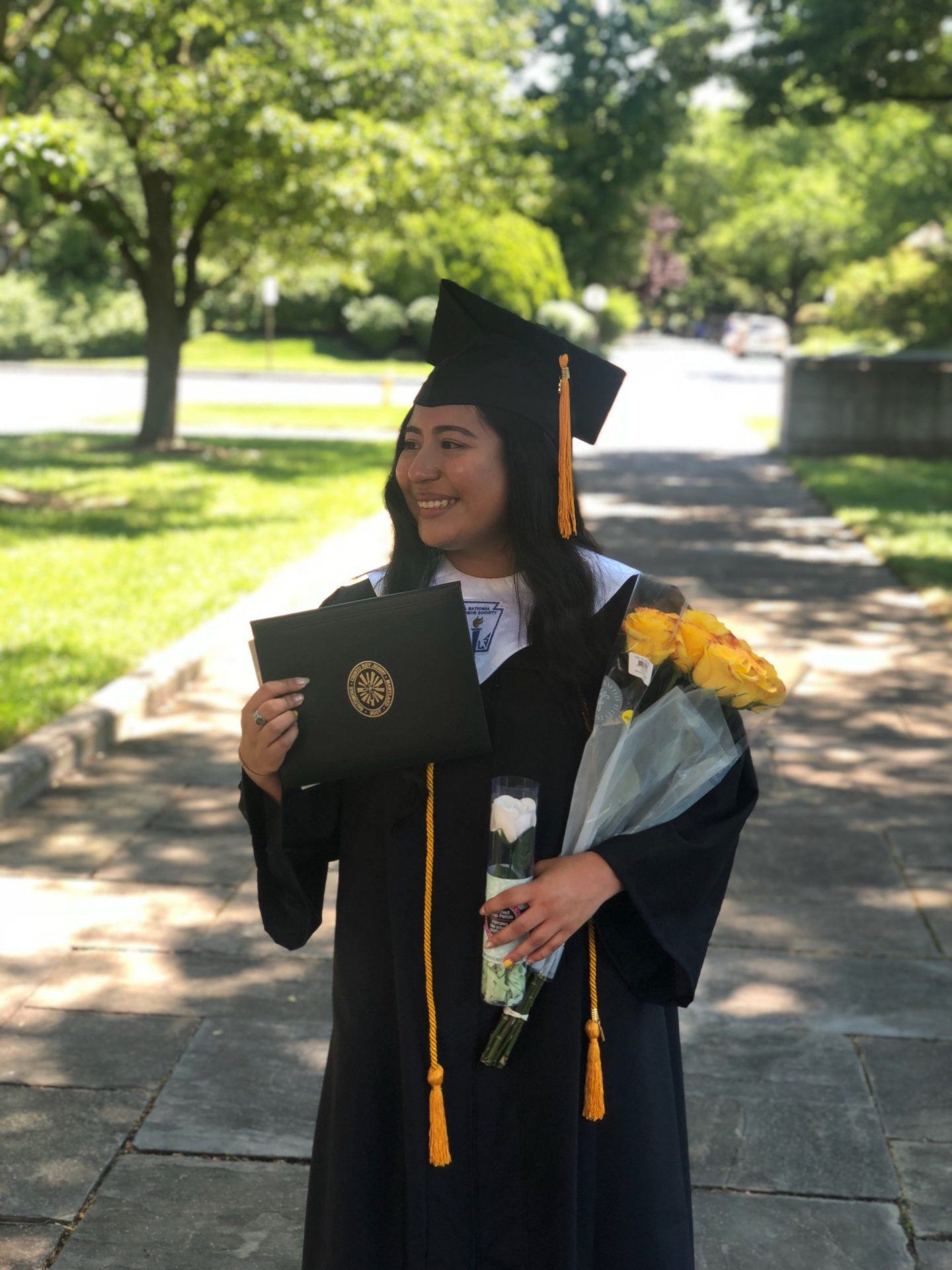 High school graduation photo of CRJ alumna Esthefani Garcia '18